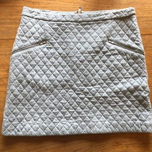 Grey-quilted skirt.